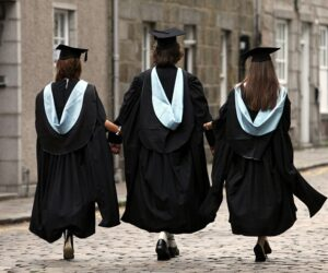 BCCNA5 Graduating students wearing gowns and mortar boards at the University of Aberdeen, Scotland, Uk at High street, Old Aberdeen
